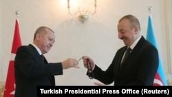 Azerbaijan -- Azeri President Ilham Aliyev receives prayer beads from his Turkish counterpart Tayyip Erdogan in Baku, February 25, 2020