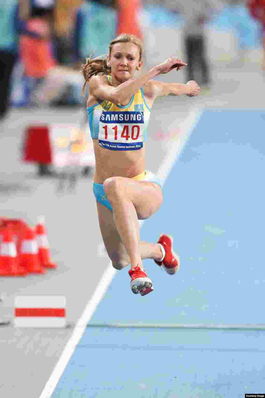 Золотуюмедаль в тройном прыжке принесла Казахстану олимпийская чемпионка Ольга Рыпакова. На Азиаде в Гуанчжоу она также выиграла золото. Фото Никиты Басова.