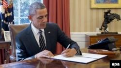 Президент США Бакак Обама в Овальном кабинете Белого дома