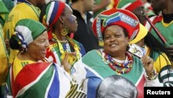 South Africa - South African fans, with one wearing a t-shirt with the image of former South African President Nelson Mandela, dance during the 2010 World Cup opening match between South Africa and Mexico at Soccer City stadium in Johannesburg, 11Jun2010