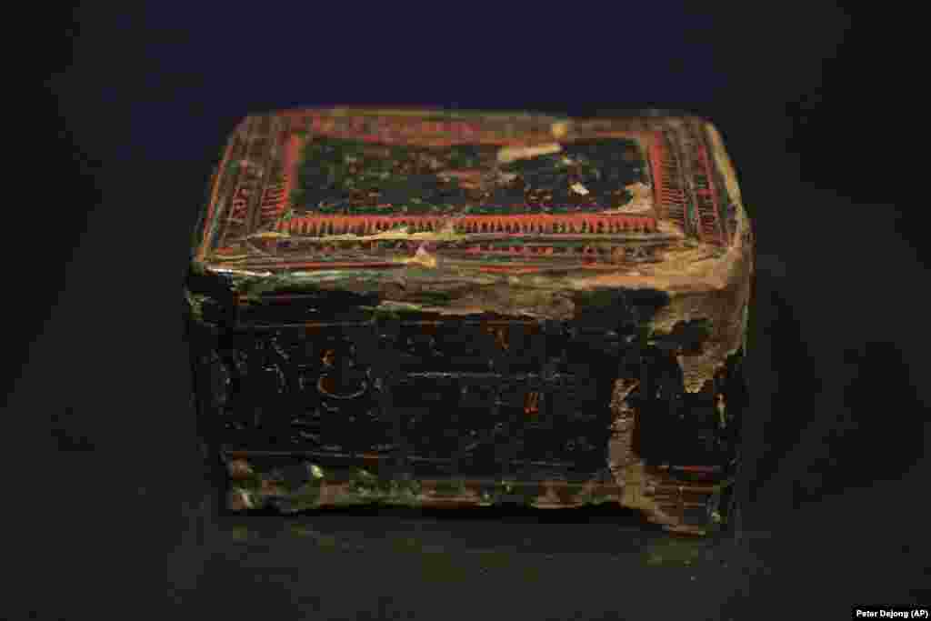 A Chinese lacquer box from the first century A.D., a burial gift for a Scythian woman