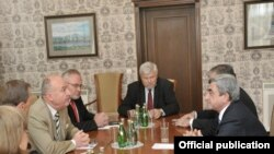 Armenia -- President Serzh Sarkisian (R) meets with the U.S., Russian and Frech co-chairs of the OSCE Minsk Group in Saint-Petersburg, 18June 2010.