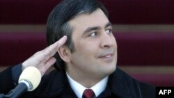 A young Saakashvili salutes during his inauguration ceremony in 2004. Many held high hopes for his leadership.