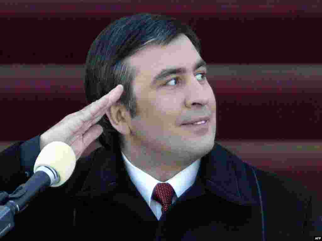 Georgian President Mikheil Saakashvili salutes while he watches a military parade during his inauguration ceremony in Tbilisi on January 25, 2004. Saakashvili, 37, was Europe's youngest head of state when he was sworn in.