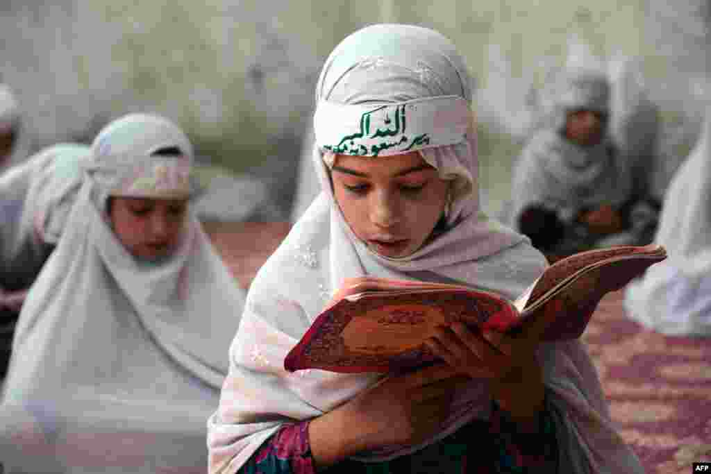 Afghan girls study the Koran at a madrasah during the month of Ramadan in Kandahar. (AFP/Jawed Tanveer)