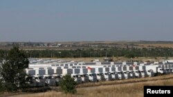 A Russian convoy of trucks carrying humanitarian aid for Ukraine waits at a camp near Kamensk-Shakhtinsky, in Russia's Rostov region.