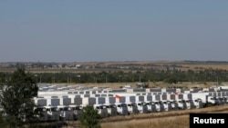 Russia -- A Russian convoy of trucks carrying humanitarian aid for Ukraine is parked at a camp near Kamensk-Shakhtinsky, Rostov Region, 15, 2014
