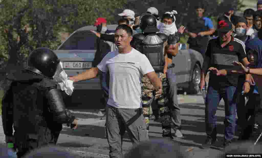 Tense scenes at a road block near the compound.
