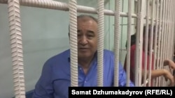 Omurbek Tekebaev in a cell during a court hearing