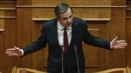Prime Minister Antonis Samaras addresses parliamentarians before a voting for the 2013 budget in Athens on November 11.