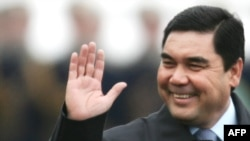 Turkmen President Gurbanguly Berdymukhammedov waves upon his arrival in Moscow on March 24.