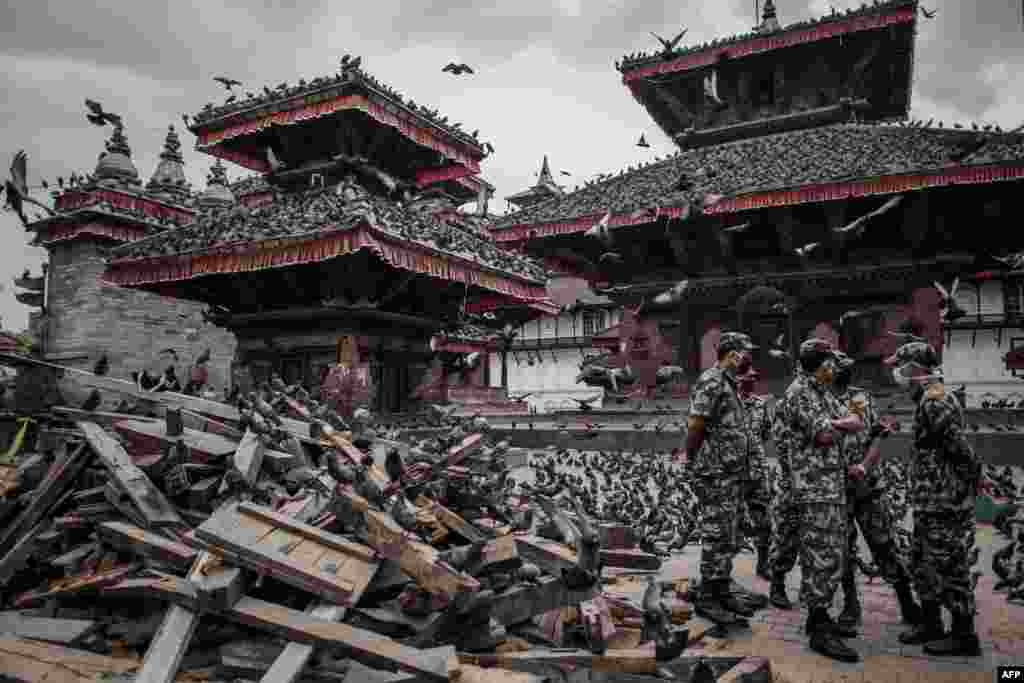 Nepalese soldiers stand next to wrecked buildings in Durbar Square in Kathmandu, a UNESCO World Heritage site that was badly damaged by last week's massive earthquake. (AFP/Philippe Lopez)