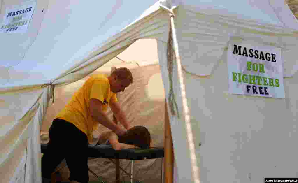 A participant takes advantage of the massage tent.