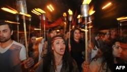 People carry torches to mark the 97th anniversary of the genocide of their kin by Ottoman Turks during World War I in central Yerevan on April 23.
