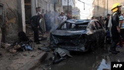 Бағдадта болған жарылыстардың бірінен кейінгі көрініс. Ирак, тамыз 2013 жыл. (Көрнекі сурет)