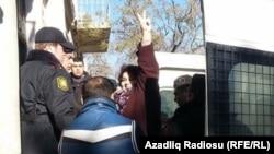 Azerbaijani journalist Khadija Ismayilova gestures to supporters at a court hearing earlier this year.