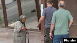 Armenia -- An elderly woman begs for money in Yerevan.