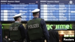 Police patrol the entrance area to the main railway station in Berlin on November 17.
