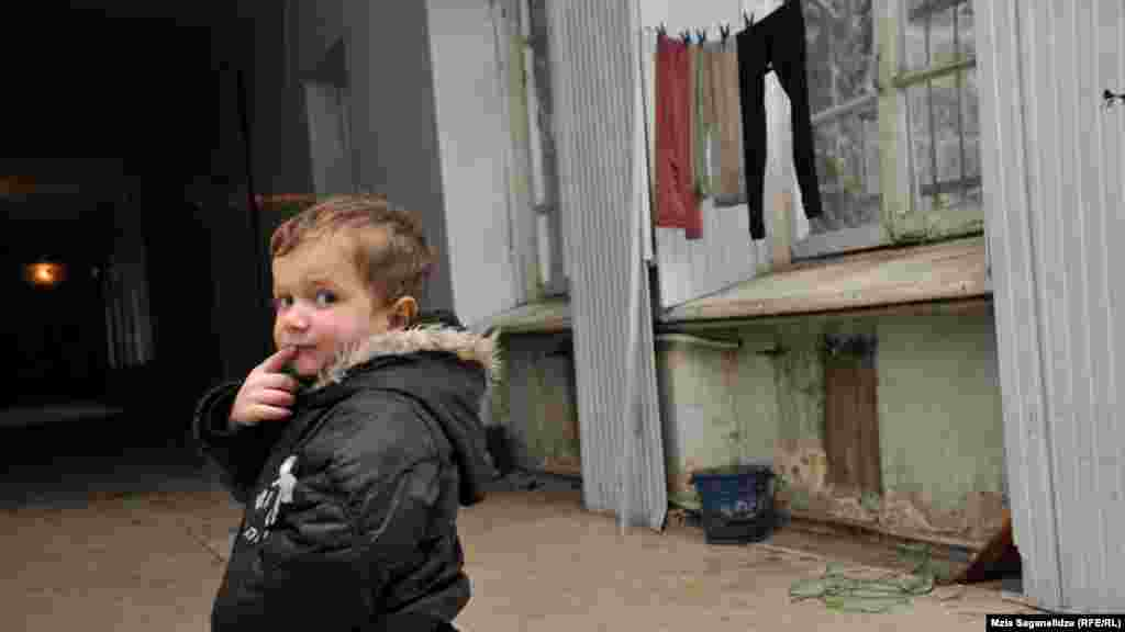 A child living in the former Railway Hospital in Tbilisi