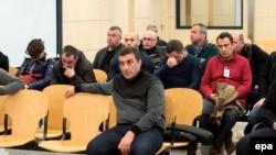Рарсейскія і грузінскія крымінальнікі на судзе ў Мадрыдзе 14 сакавіка сёлета.