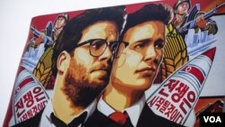"A billboard promoting the movie ""The Interview,"" before Sony decided to pull the movie from distribution."