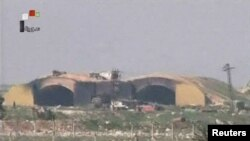 A still image, taken from a video broadcast on Syrian state television, shows a Syrian army airbase that was hit by a U.S. strike near the city of Homs, April 6, 2017. File photo