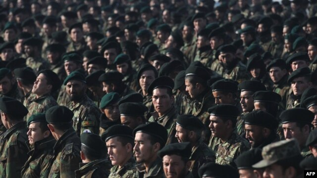 Newly graduated Afghan National Army soldiers attend their graduation ceremony at a training center in Kabul in January