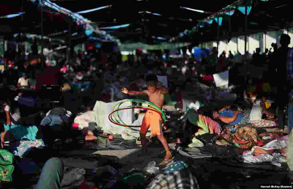 Osman Joel Hernandez, a 6-year-old migrant boy, part of a caravan of thousands traveling from Central America en route to the United States, plays with a hula hoop as he rests in a makeshift camp in Juchitan, Mexico, on October 31. (Reuters/Hannah McKay)