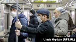 People wear face masks as they ride the subway in Minsk on April 20.