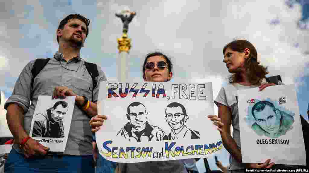 Demonstrators hold signs calling for the release of Ukrainian film director Oleh Sentsov and fellow prisoner Olesandr Kolchenko in Kyiv's Independence Square on July 13. Kolchenko and Sentsov were arrested in Crimea in 2014 after Russia seized the Ukrainian region. A Russian court in 2015 convicted them of extremism charges, which the men and their supporters consider politically motivated. (Serhii Nuzhnenko, RFE/RL)