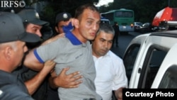 Rovshan Nasirli being detained by police at a pro-democracy rally in Baku on June 19.