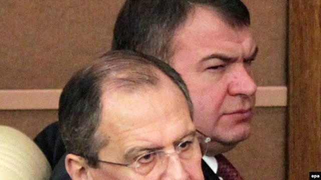 Russian Foreign Minister Sergei Lavrov (front) and Defense Minister Anatoly Serdyukov attended the January 14 session of the State Duma, where the New START cleared another hurdle.