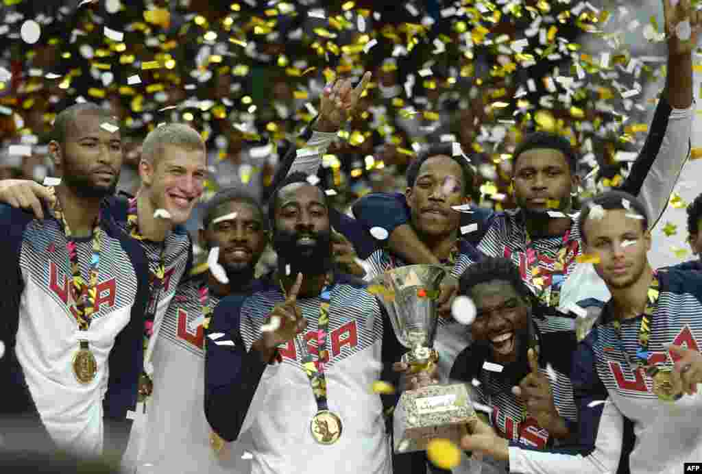 U.S. players celebrate after winning the final match of the 2014 FIBA world basketball championship versus Serbia at the Palacio de los Deportes in Madrid. (AFP/Gerard Julien)