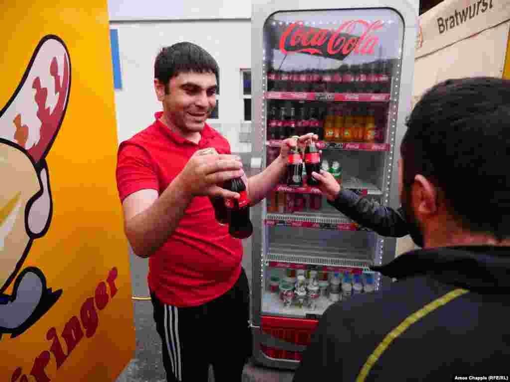 Makhitan Nahapetian, the owner of a local food stall, handed out free Cokes and other drinks to protesters.