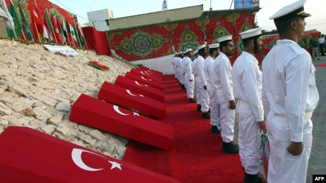 Hamas naval police hold a ceremony for the nine Turks who were shot dead during the Israeli raid on Gaza-bound aid ships in the Gaza City port following the May 2010 incident.