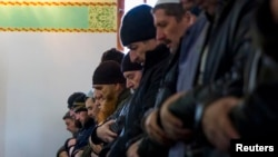 Crimean Tatars pray in the Khan Chair mosque in Bakhchisaray, near Simferopol.