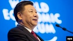 Давос, Швейцария. Председатель КНР Си Цзиньпин выступает на Всемирном экономическом форуме, 17 января 2017 года