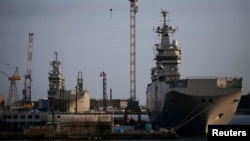 The Mistral-class helicopter carriers Sevastopol (right) and Vladivostok are seen at the STX Les Chantiers de l'Atlantique shipyard site in Saint-Nazaire, France, on May 21.
