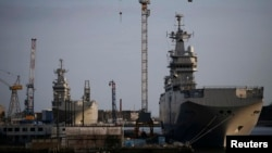 The Mistral-class helicopter carriers Sevastopol (right) and Vladivostok are seen at a shipyard in Saint-Nazaire in May.