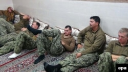 U.S. sailors are shownn in an undisclosed location in Iran in this handout picture released on the official website of Iranian Revolutionary Guards Corps on January 13.