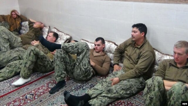 U.S. sailors are seen in an undisclosed location in Iran in this handout picture released on the official website of Iran's Islamic Revolutionary Guards Corps on January 13.