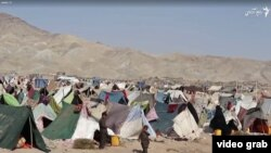 A makeshift refugee camp where thousands of families driven from their homes by a devastating drought live outside the city of Herat.