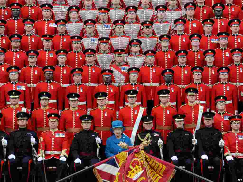 Elizabeth and Philip (front row, center) pose for an official photograph with the Grenadier Guards after presenting the regiment with their new colors in 2010.