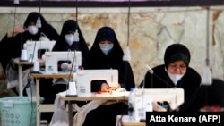 Iranian women make face masks and other protective items in the capital, Tehran, amid a coronavirus outbreak, which has killed thousands of people in the country.