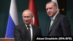 Russian President Vladimir Putin (left) shakes hands with Turkish President Recep Tayyip Erdogan in Ankara in December 2017