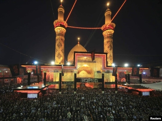 Shi'ite pilgrims pray at the Imam Abbas shrine in the holy city of Karbala.