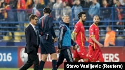 Soccer match between Montenegro and Russia was abandoned after crowd trouble and a player skirmish.