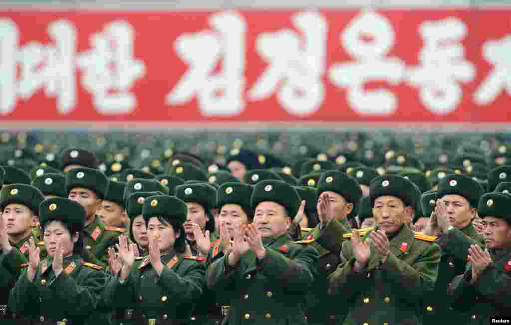 North Korean soldiers attend a rally to celebrate the launch of the Unha-3 rocket, which successfully placed a satellite into polar orbit. (Reuters/Kyodo)