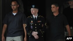 U.S. Army Private Bradley Manning (center) is escorted from a court-martial hearing in Fort Meade, Maryland earlier this week.