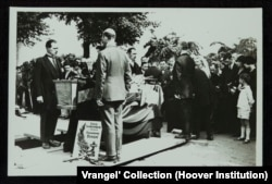 "Wrangel's funeral in Belgium. The poster reads, ""From the Union of Gallipoli troops in Belgium to their beloved leader."""